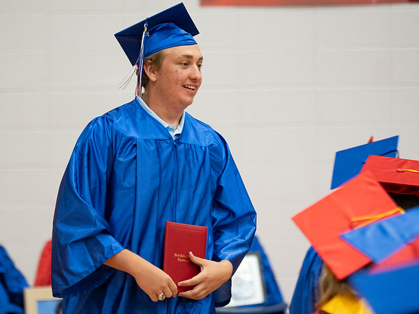West Noble graduate Jonathan Drew reacts after receiving his diploma during Friday's  West Noble High School Class of 2021 Commencement at West Noble High School in Ligonier.