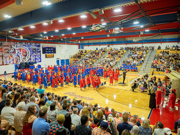 West Noble graduate class of 2021 watch their remaining two classmates enter the gym during Friday's  West Noble High School Class of 2021 Commencement at West Noble High School in Ligonier.