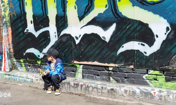 Boy and street art, Mission, San Francisco, USA