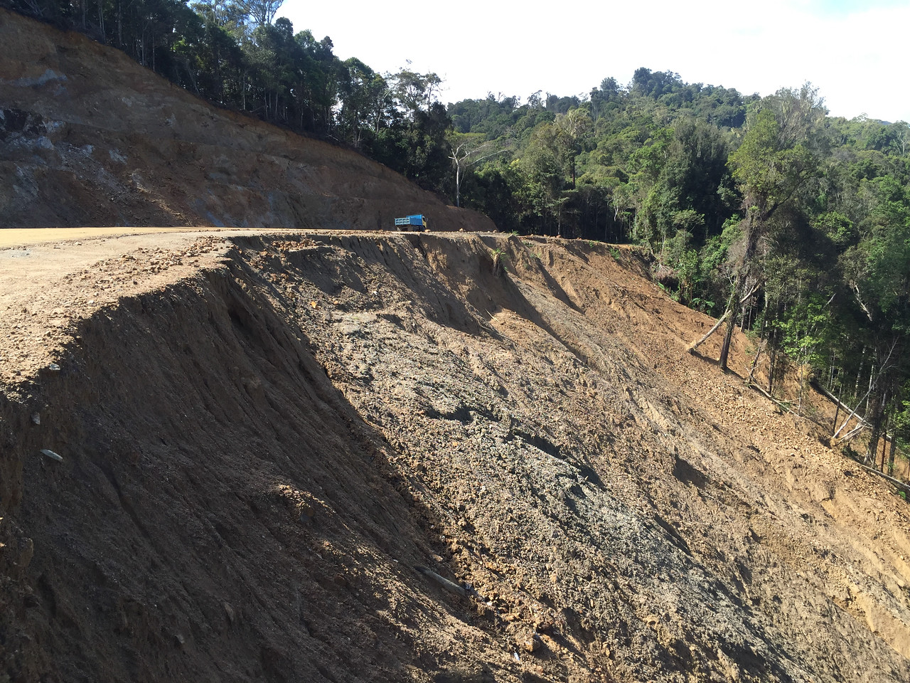 A new road, cutting a deep gash into the mountainside.