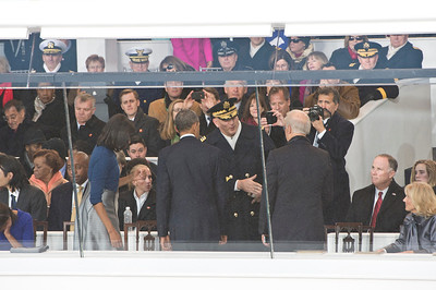 Cadets of the US Military Academy at West Point march past President Barack Obama and General Ray Ordierno in the reviewing stand with other dignitaries and members of the Joint Chiefs of Staff during the Presidents 2nd Inaugural Parade in Washington DC on January 21, 2013
