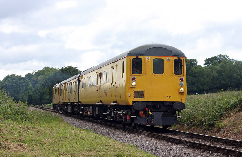 97301, propelling 07.12 St Erth-Bishops Lydeard, via Minehead, Network Rail track-testing train, Leigh Wood, near Stogumber, 9-6-11.