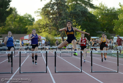 Gridley's Stephanie Cardenas clears the final hurdle in the 300-meter as she wins the race Friday, April 21, 2017, during the West Valley Invitational at Harrison Stadium in Oroville, California. Left to right, Core Butte's Janna Glaspie, Oroville's Selina Shillig, Cardenas, Wooster's Mackenna Miller, and Enterprise's Zoey Pitts. (Dan Reidel -- Enterprise-Record)