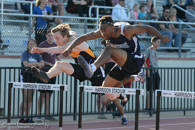 Enterprise's Brock Fischer, left, and Pleasant Valley's Jamarquez Abrams race over hurdles Friday, April 21, 2017, during the West Valley Invitational at Harrison Stadium in Oroville, California. Abrams won the race. (Dan Reidel -- Enterprise-Record)