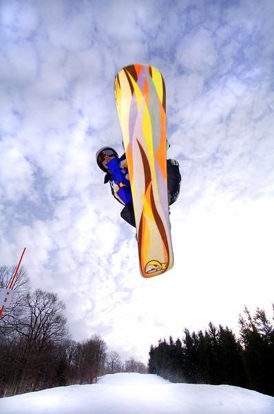 Flying snowboarder at Cannan Valley Resort State Park ski area, Tucker Co, WV.