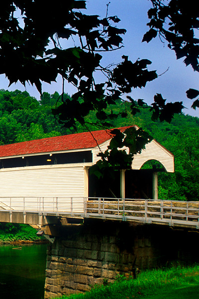 PHILIPPI COVERED BRIDGE<br />   Also known as the Lemuel Chenoweth Bridge after it's builder, Philippi Bridge was constructed at a cost of about $12,180 in 1852.  Lemuel and Eli Chenoweth of Beverly built the superstructure and Emmett J. O'Brien was the masonry contractor.  It nearly burned to the ground in February 1989, and was completely restored and opened to traffic in the summer of 1991.   <br />   The span was built to facilitate use of the Beverly and Fairmont Road, which had been built in turn to stimulate use of the Staunton-Parkersburg Turnpike.<br />   One of six two-lane covered bridges remaining in the United States; it is the only one that still serves federal highway traffic – US route 250.<br />   It is believed to have escaped destruction during the Civil War because Union troops secured it early in the war.  Used by both Northern and Southern troops, it is sometimes recognized as the site of the first land battle of the Civil War.<br />   This bridge is located at the junction of US routes 119 and 250 in Philippi, WV.