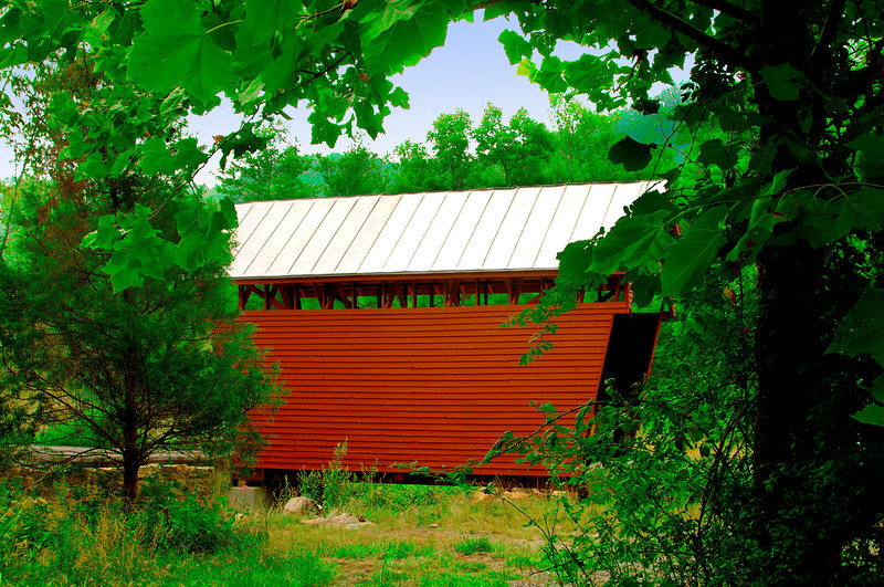 LILY DALE OR LAUREL CREEK COVERED BRIDGE<br />   This bridge was built in about 1911.  Lewis Miller constructed the stone abutments and Charles Robert Arnott built the superstructure.  At 25 feet in length and 13 feet wide it is the smallest covered bridge in the state.  It was completely restored in the late 1990's.<br />   To locate the bridge start on US route 219 in Union, WV and drive south on US 219 3.2 miles to Lily Dale Road 219/7 at Salt Sulphur Springs.  Turn right and drive down Lily Dale road for 3 miles where the road forks.  Take the right fork, Laurel Creek Road 219/11, and continue for 1.4 miles directly to the bridge over Laurel Creek.