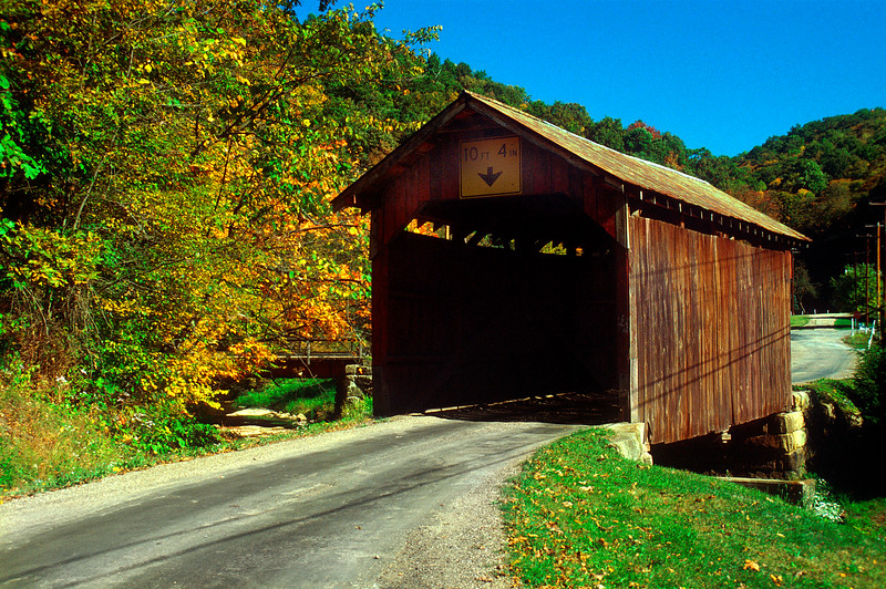 FISH CREEK COVERED BRIDGE<br />   Accurate history of the construction of Fish Creek Bridge is unknown, but it is thought to have been built about 1880-81 by relatives of C.W. Critchfield.  The bridge is 36 feet long and 13 feet wide.  It was completely restored in 2000.<br />   Fish Creek covered Bridge is located at the junction of US route 250 and secondary road 13 near Hundred in Wetzel County West Virginia.