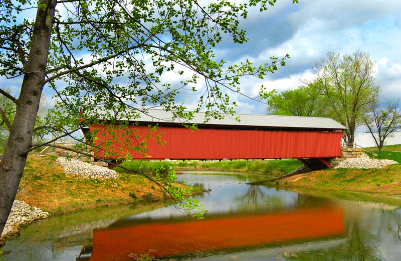 MILTON OR MUD RIVER COVERED BRIDGE<br />   Originally located on East Mud River Road this bridge was moved to the Cabell County Fair Grounds in 1997.  It was built in 1875-76, and is sometimes confused with a separate earlier covered bridge built nearby in 1834 and replaced in 1955.  Supported by a modified Howe truss it is 208.5 feet in length and 14 feet wide.  It was totally restored in 2001.<br />   From interstate 64 East of Huntington, WV take exit 28 (Milton) and turn toward Milton, drive 3/10 mile to US route 60.  Turn right onto US route 60 West and drive 4/10 mile to 1st stoplight.  Turn left onto Fair Ground Road and drive 7/10 mile to One Pumpkin Way.  Milton Bridge is located on your left.
