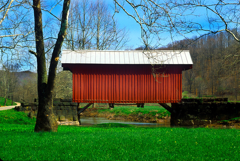 WALKERSVILLE COVERED BRIDGE<br />   About 39 feet long and 12 feet wide and Queenpost truss design, this bridge was built across the right fork of West Fork River in 1903 by John G. Sprigg.  It is to be completely restored in 2003.<br />   To locate this bridge take Roanoke exit 91 from interstate 79 south of Weston, WV.  Drive south on US route 19 for 13 miles to Big Run Road 19/17 just south of Walkersville.  Turn right and the bridge will be within sight.