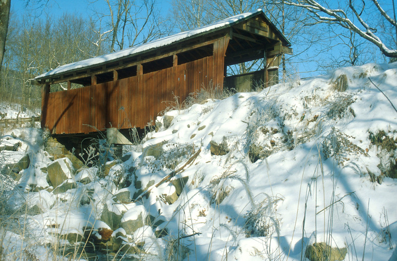 HERNS MILLS OR MILLIGAN CREEK COVERED BRIDGE<br />   Unfortunately the names of the builders have been lost, but it is believed this bridge was built sometime between 1879 and 1884.  It was built using a variation of the Queenpost truss design and is 54 feet in length and 10.5 feet wide.  At one time this bridge provided access to the S.S. Hern Mill.  It was completely restore in 2000.<br />   To locate this bridge from the junction of US routes 219 and 60 in downtown Lewisburg, WV take US route 60 west 3.5 miles to Bungers Mill Road 60/11.  Turn left and drive 2/10 mile to Herns Mill Road 40 and turn left again.  Drive 1 mile directly to Herns Mill Bridge over Milligan Creek.