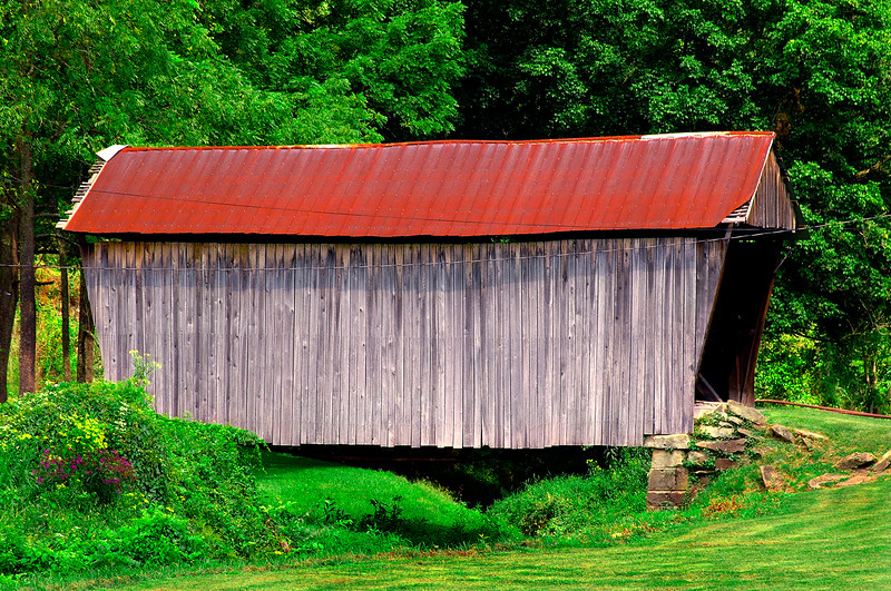 CENTER POINT COVERED BRIDGE<br />   The only covered bridge in Doddridge County the Center Point Bridge was built sometime between 1888-90.  T.W. Ancell and E. Underwood built abutments with John Ash and S.H. Smith building the superstructure.  It is located on private land over Talkington Fork of McElroy Creek, and is 42.1 feet in length and 12.6 feet wide.  Citizens of Center Point  restored it in the early 1980's, and it was completely restored once again in 2004.<br />   To locate it, from US route 50 west of Salem, WV take secondary route 23.  Drive 10.2 mile to Pike Fork Road 10.  Turn right and the bridge will be within sight.