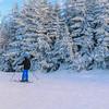 Skier blue helmet starting down the mountain