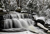 Small waterfall on stream in the winter