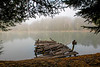 Old dock on lake in the fog in the morning