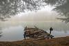 Old dock on lake in morning