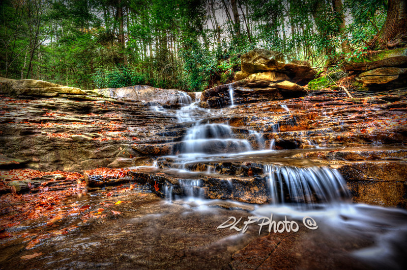 """Waterfall On Small Creek Going Into The Big Sandy River<br /> <br /> Framed, metal, canvas order at this website - <a href=""""http://fineartamerica.com/featured/waterfall-on-small-creek-going-into-the-big-sandy-river-dan-friend.html"""">http://fineartamerica.com/featured/waterfall-on-small-creek-going-into-the-big-sandy-river-dan-friend.html</a>                                                             .............................................pixel paintography"""