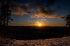Sun setting in winter time top of mountain