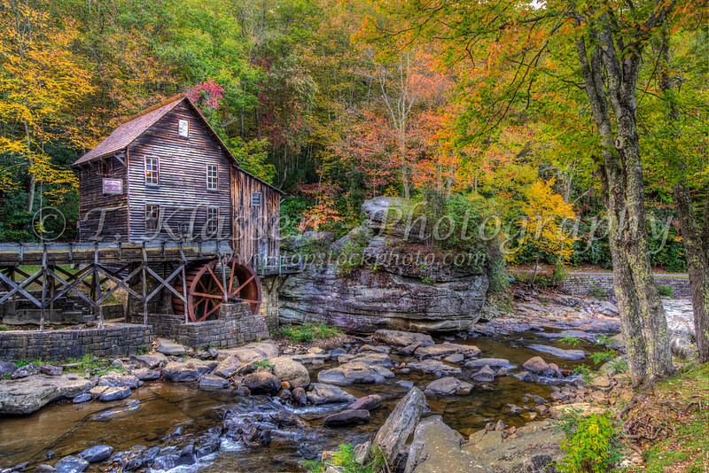 Glade Creek Mill at Babcock State Park with fall foliage color, West Virginia, USA.