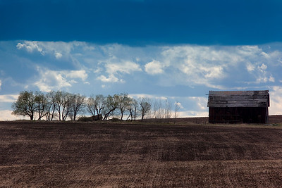 I keep coming back to this barn, because the sky is frequently dramatic, as it was on this day as i returned from fly fishing.  I set the shot up just as the rain started.