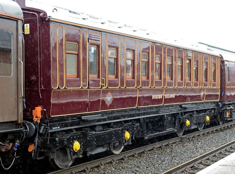 LNWR dining saloon No 159 (99880), 5Z45, Carnforth, Sat 18 May 2013.  This coach was last seen wearing LNWR livery but has recently been repainted maroon.  It has kept the Queen of Scots badges.