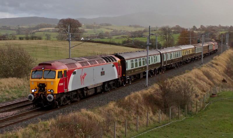 57302 Virgil Tracy, 1Z58, Docker, Fri 7 November 2008 - 1502.    The return leg of a private charter from Stoke to Carlisle, worked via Settle by 57312 seen here on the rear.  The train was formed of the Queen of Scots stock: BR Mk 1 service cars Nos 2 & 1 (99035 & 99886); 1930 GWR first class saloon No 9004; 1891 LNWR dining saloon No 159; 1912 GNR first class saloon No 807; and Caledonian Rly saloon No 41, originally bult in 1892.  These are the oldest coaches authorised to run on the national network.  This train almost cetainly ran in connection with the train's purchase by the West Coast Rly Co.