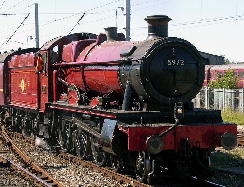 5972 Olton Hall, Carnforth, Wed 8 September 2004 - 1226 1.  'Hogwarts Castle' sets off on a light test run to Hellifield with a support coach before going to Fort William for more Harry Potter filming..