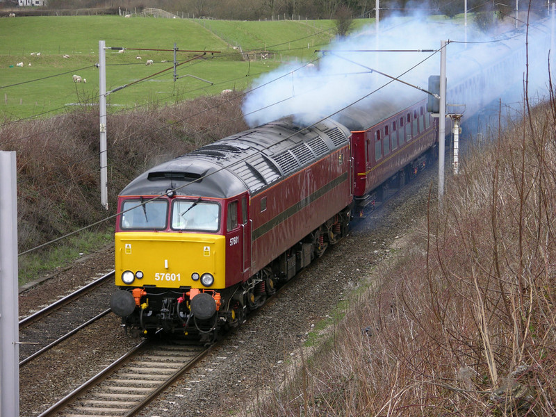 57601, clagging out of Carnforth, Fri 19 March 2004 - 1313.
