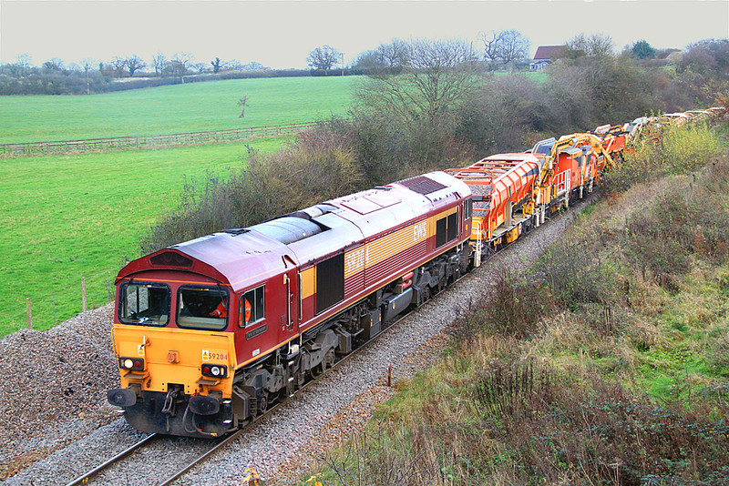 Further along the branch, a rather rattly-sounding 59204 restarts a High Output Ballast Cleaner set en-route to a work-site a little way ahead on the climb to Merehead.  03/12/11.