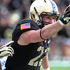 Army's Nate Combs holds up the football after scoring a rare defensive touchdown near the end of the fourth quarter.  Combs recovered a turnover by Air Force near their own end-zone, resulting in the TD.