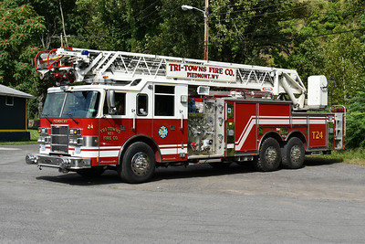 Piedmont, West Virginia (Tri Towns VFC) in Mineral County:  Truck 24 is a 2000 Pierce Dash 105' with a 1500/300 and Pierce job number 10954.  It has steerable rear wheels.