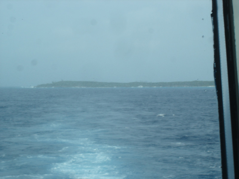 Our only view of Half Moon Cay, from the Vista dining room aft windows as we sailed away from the winds and rough waves that canceled our visit :(