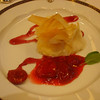 Golden pear purse: phyllo dough filled with vanilla cream and pear with red wine coulis.