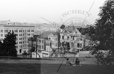 Lower Postcard Row - Steiner & Fulton w/ city background