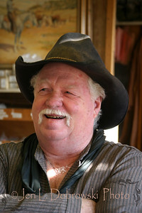 Croft, Jerry  Deadwood, South Dakota  2005: in his leather shop, formerly a one-room schoolhouse  *Saddlemaker & buffalo producer