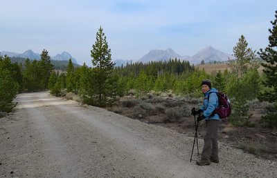 """One of the hikes that we had our eye on was to the Bench Lakes, above Redfish Lake.  Our """"trailhead"""" was our campsite.  Here, Susie is hiking on a short stretch of road to get over to the real trailhead."""