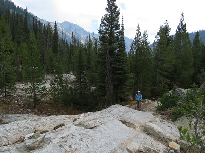 The trail mosies along.  Here is Susie getting ready to climb a rock slab.