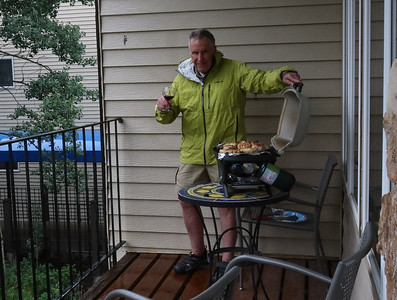 Roger grilling chicken in the rain.  (Under the deck overhang.)