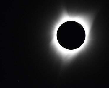 Totality.  Once totality starts, you have to take the solar filter off your camera lens, and start taking photos.  Let this caption drop out of the way and look for the planet or star in the lower left of the photo.