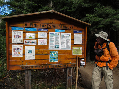 Hiking Day 1.  We picked Eightmile Lake in the Alpine Lakes Wilderness.  The road up to the trailhead is steep, rough and graveled and takes a bit of time.  Here is Roger looking at the permit info board.