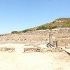 Ancient Kamiros panorama with Doric temple ruins.