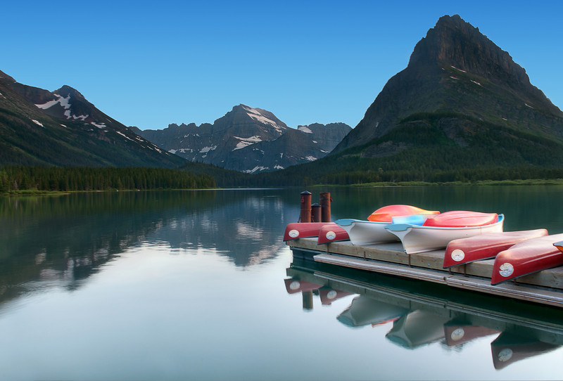 Many Glacier Hotel sits on the shores of Swiftcurrent Lake with Mount Gould as a backdrop