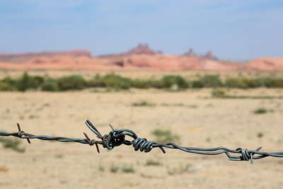 Barbed Wire Fencing and the Desert landscape, Navajo Country near Kayenta, Arizona