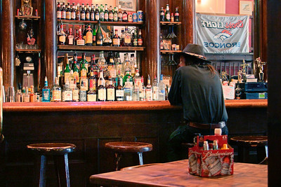 Man Sits in Old Time Cowboy Bar, Georgetown Colorado