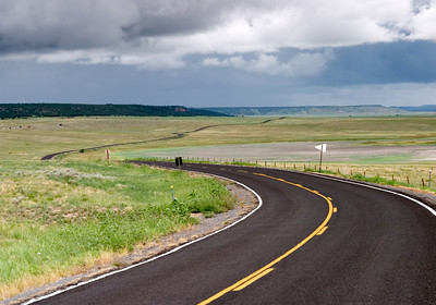 Isolated Country Road Winding Through The High Plains of New Mex