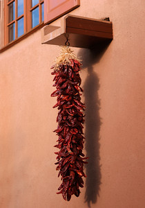 Hanging Peppers From an Adobe Building in New Mexico