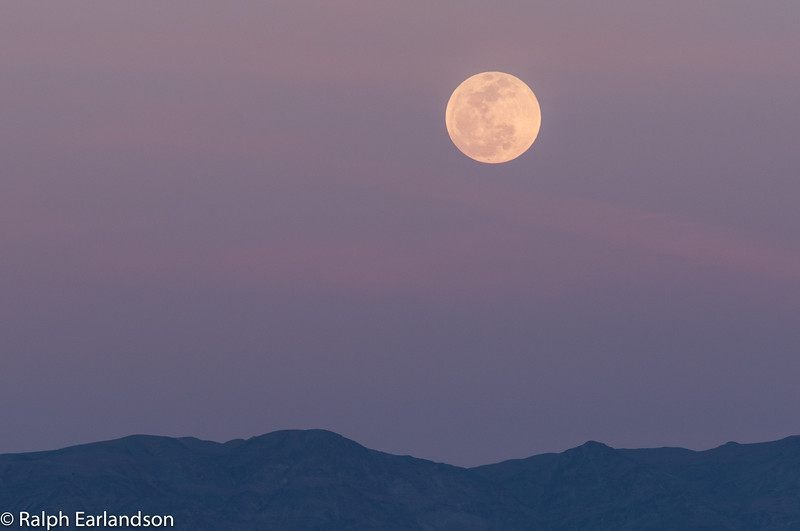A rising full moon in Death Valley.