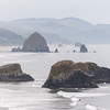 Haystack Rock and other seastacks at Cannon Beach, Oregon, seen from Ecola State Park.