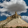 A large cumulus cloud over a sandstone butte along Utah Highway 12.