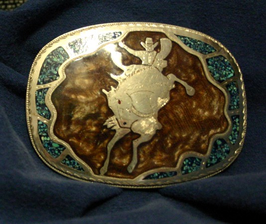 """Bronc Rider"" buckle, crushed turquoise and polymer resin set off Western Style Freehand engraved on nickel."